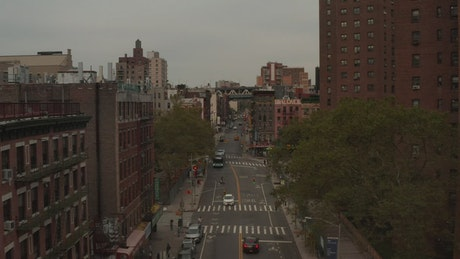 Low flight over an avenue in Chinatown