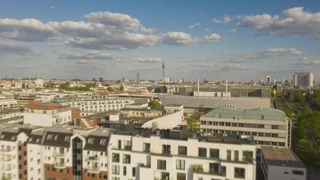 Low flight over the rooftops of Berlin's buildings