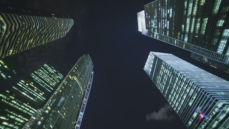 Low static view of skyscrapers at night
