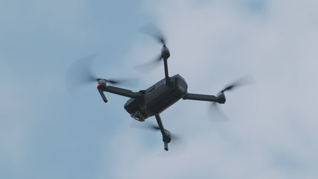Low view of a drone flying against the sky