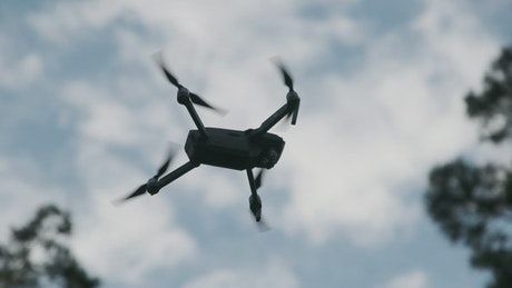 Low view of a drone flying in slow motion