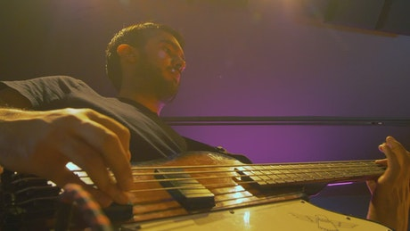 Low view of a musician with his electric bass