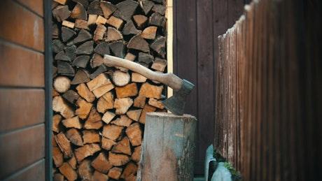 Lumberjack chopping a small log with an ax