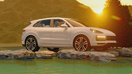 Luxury vehicle on rocks in a lake