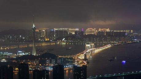 Macau tower and bridge traffic at night