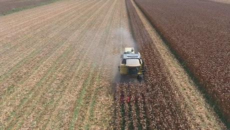 Machine harvesting the crops