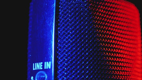 Macro shot of a microphone with red and blue light
