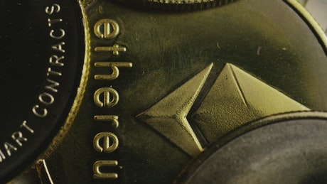 Macro shot of Ethereum golden coins