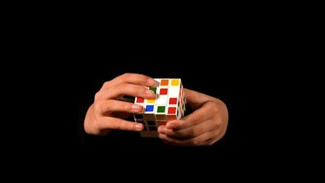 Magician solving a 4x4 rubik cube