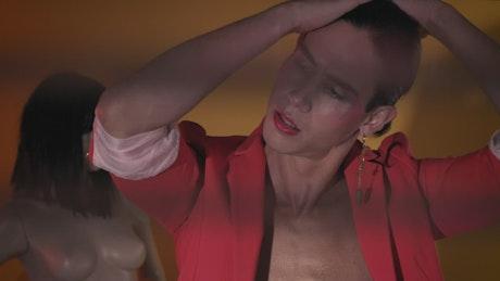 Make-up gay man posing captivatingly