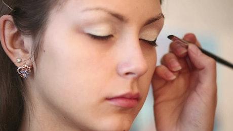 Makeup artist working on a woman