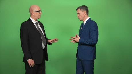 Making a business deal with green screen behind