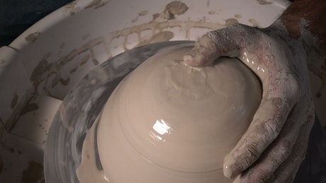 Making a clay bowl in the workshop