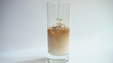 Making cold coffee with milk