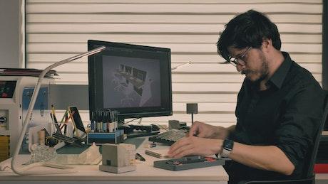 Male designer working in his studio