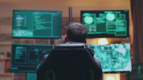 Male hacker sitting at his desk
