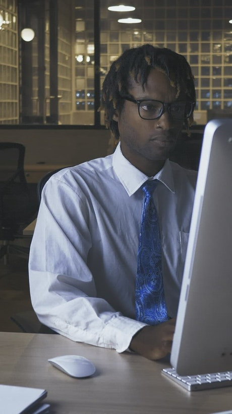Male office worker working in an lonely office