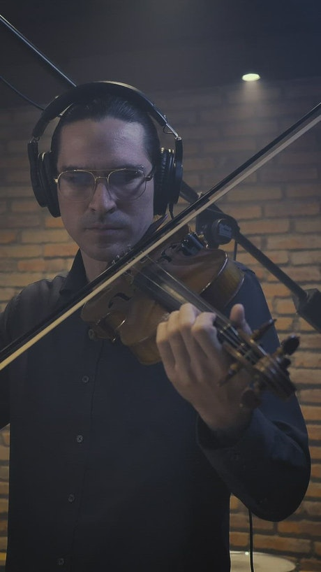 Male violinist playing in a recording studio