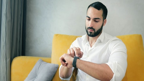 Man activates futuristic hologram browser with smart watch