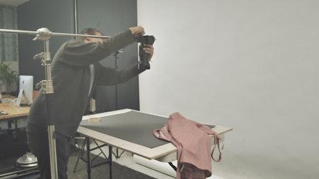 Man adjusting a camera in the studio