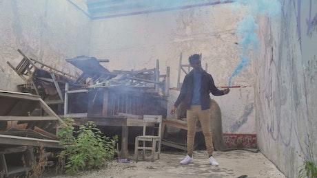 Man and smoke bomb