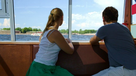 Man and woman enjoying a boat tour