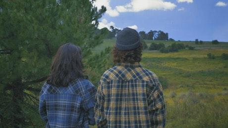 Man and woman enjoying a natural scenery