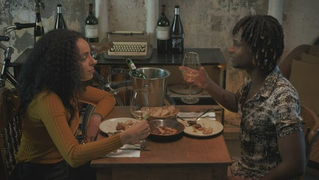 Man and woman having a romantic dinner with wine