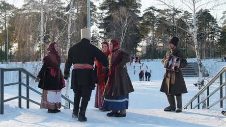 Man and woman in Russian folk costumes dancing