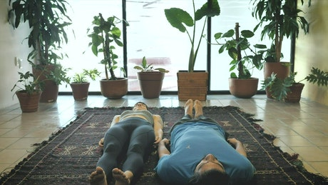 Man and woman in sitting yoga pose