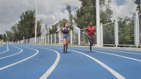 Man and woman jogging on a running track