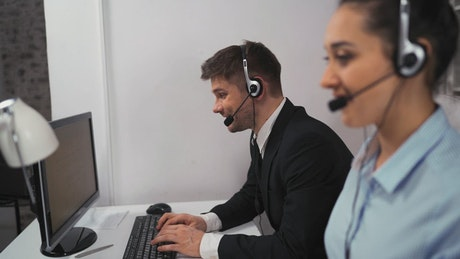 Man and woman working in a call center