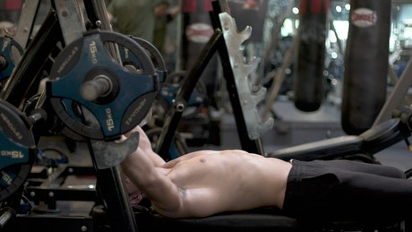 Man at the gym exercising with a dumbbell