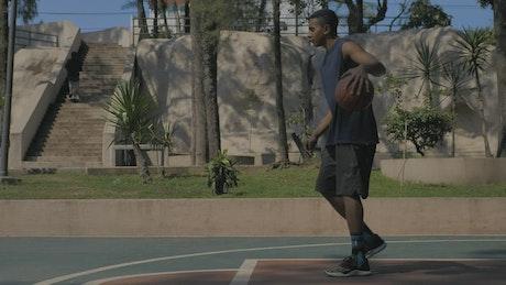 Man bouncing a basketball ball