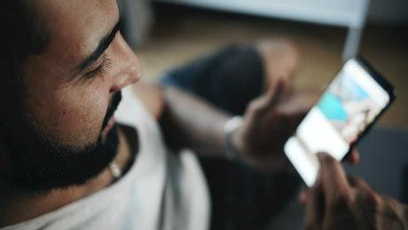 Man browsing social media on smartphone top view