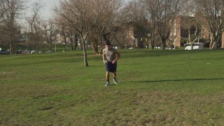 Man checking his phone while jogging