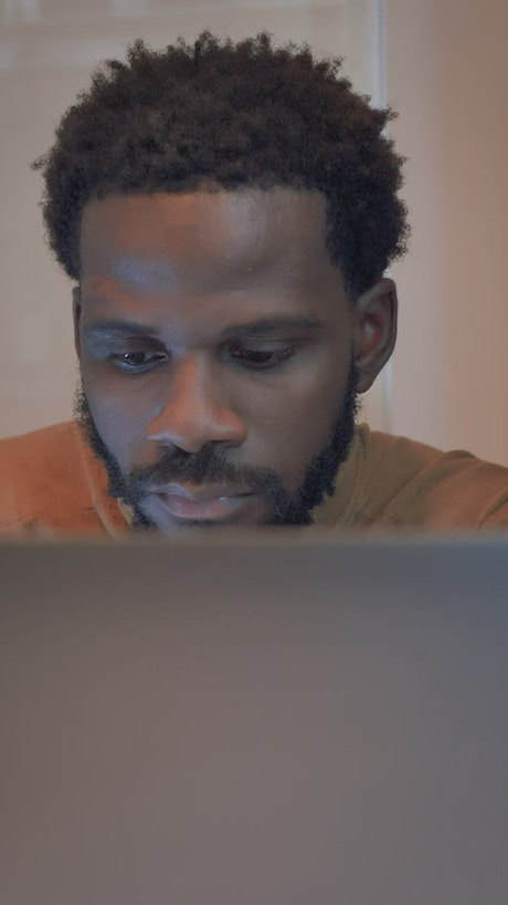 Man closes his laptop after work