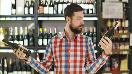 Man confused over which wine to buy