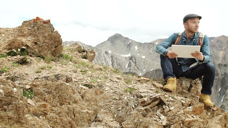 Man connected to a network on a mountain