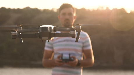 Man controlling drone with with remote controller