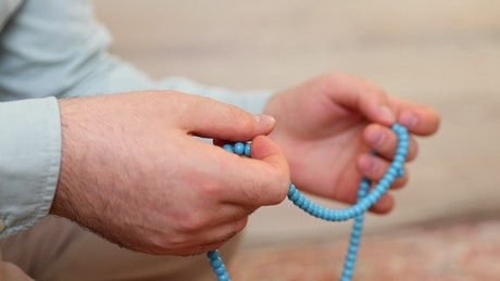 Man crossing a bad japa beads blue