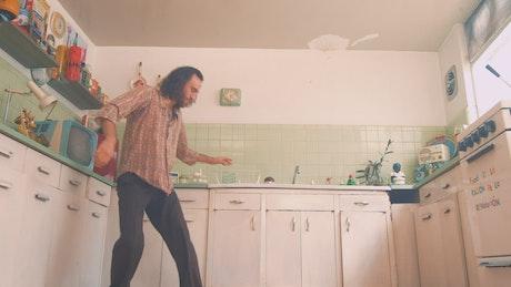 Man dancing in a retro kitchen
