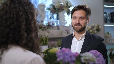 Man discussing a flower arrangement