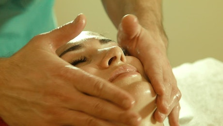 Man doing a face massage