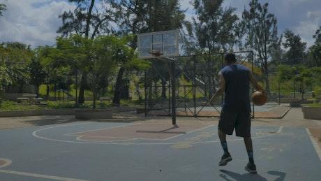 Man doing a slam dunk