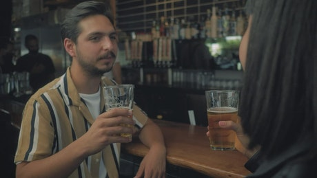 Man drinking beer with his date