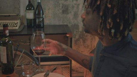 Man drinking from his glass of wine on a romantic date