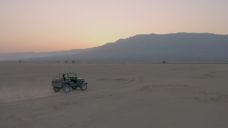 Man driving a jeep crossing a desert