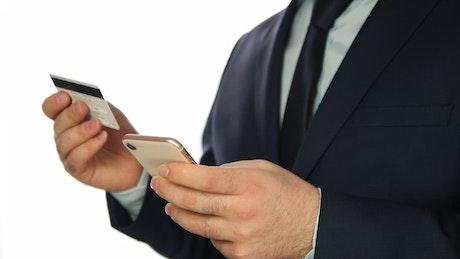Man entering bank data in a cellphone