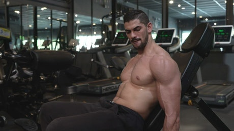 Man exercising biceps in a gym
